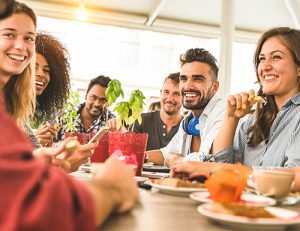 Group of friends laughing during a meal