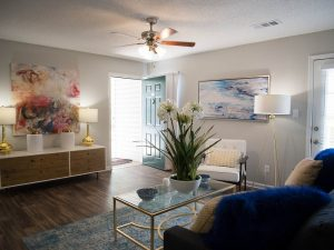 Entrance to spacious living room with ample seating and ceiling fan at The Willows apartments for rent