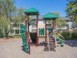Children's playground at The Willows apartments for rent in Spartanburg, SC