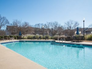 Outdoor swimming pool with sundeck at The Willows apartments for rent