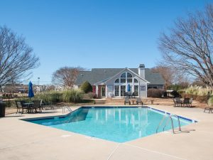 Outdoor swimming pool at The Willows apartments for rent