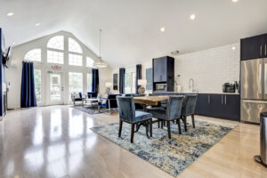 Resident community clubhouse with ample seating and kitchen at The Willows apartments for rent