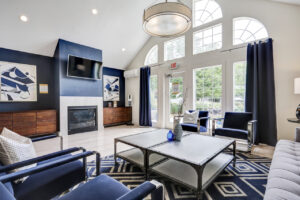 Lobby with seating area and TV at The Willows apartments for rent in Spartanburg, SC