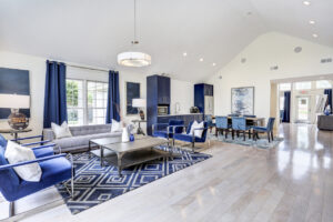 Resident lounge with ample seating and community kitchen at The Willows apartments for rent
