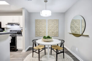 Dining area with table, two chairs, and view of kitchen at The Willows apartments for rent in Spartanburg, SC